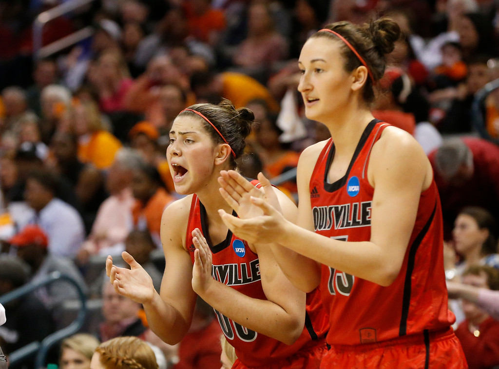 . Louisville forwards Sara Hammond, left, and Cortnee Walton cheer from the bench in the first half of the Oklahoma City regional final against Tennessee in the NCAA women\'s college basketball tournament in Oklahoma City, Tuesday, April 2, 2013.  (AP Photo/Sue Ogrocki)
