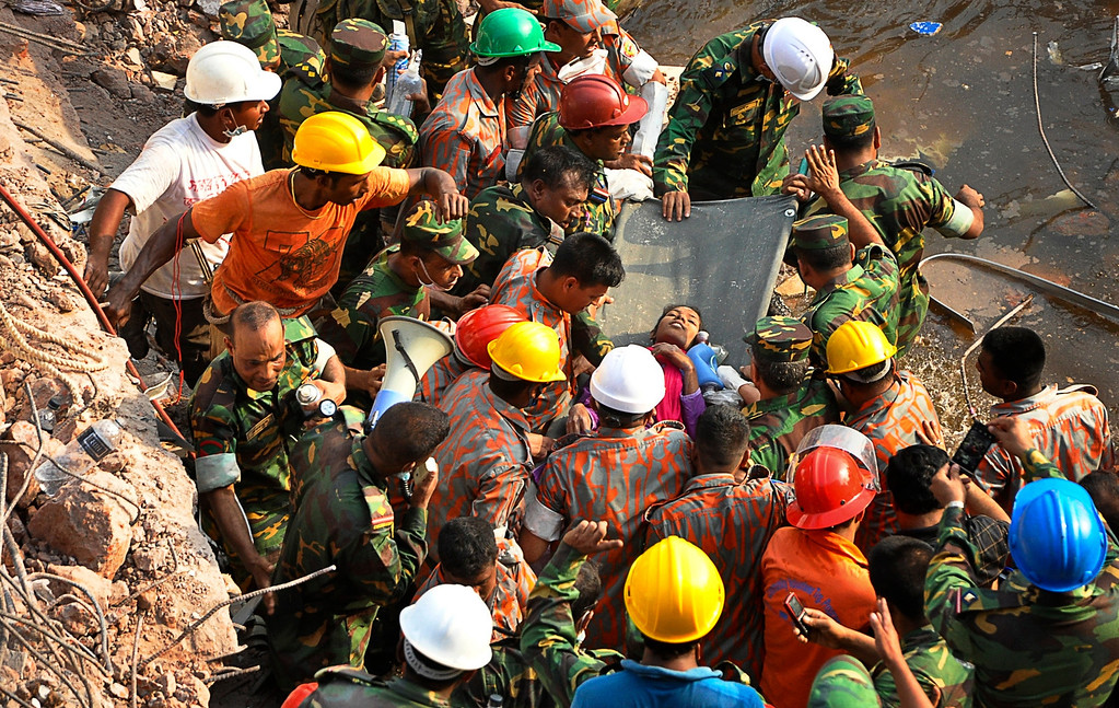 . Rescuers carry a survivor pulled out from the rubble of a building that collapsed in Savar, near Dhaka, Bangladesh, Friday, May 10, 2013. (AP Photo)