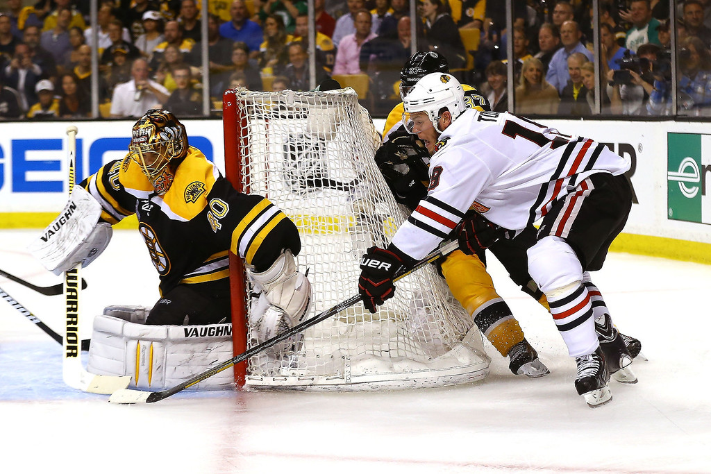 . Jonathan Toews #19 of the Chicago Blackhawks tries a shot on goal against Tuukka Rask #40 of the Boston Bruins in Game Three of the 2013 NHL Stanley Cup Final at TD Garden on June 17, 2013 in Boston, Massachusetts.  (Photo by Bruce Bennett/Getty Images)