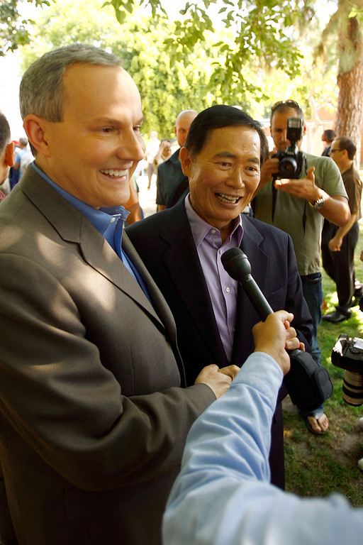 . WEST HOLLYWOOD, CA - JUNE 17:  Actor George Takei (R), known for his role in the science fiction TV series Star Trek, and his fiance Brad Altman talk to reporters while other gay couples wed as the era of same-sex marriage begins in California, June 17, 2008 in West Hollywood, California. Takei and Altman will marry at the Japanese National Museum in Los Angeles. Conservative and religious groups hope that voters will support their initiative on the November ballot to alter the state constitution to permanently ban gay marriages. Meanwhile, many business owners are looking for a wedding related sales boom. A study released by University of California Los Angeles (UCLA) this month projects that nearly half of the state\'s 102,600 same-sex couples will marry in the next three years and, along with same-sex couples from other states, will spend more than $683 million on weddings, honeymoons and other marriage-related activities.  (Photo by David McNew/Getty Images)