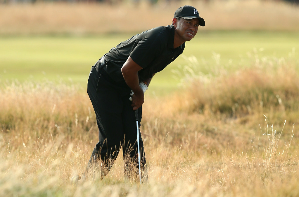 . US golfer Tiger Woods reacts in the rough on the 16th hole during his second round, on day two of the 2014 British Open Golf Championship at Royal Liverpool Golf Course in Hoylake, north west England on July 18, 2014. ANDREW YATES/AFP/Getty Images