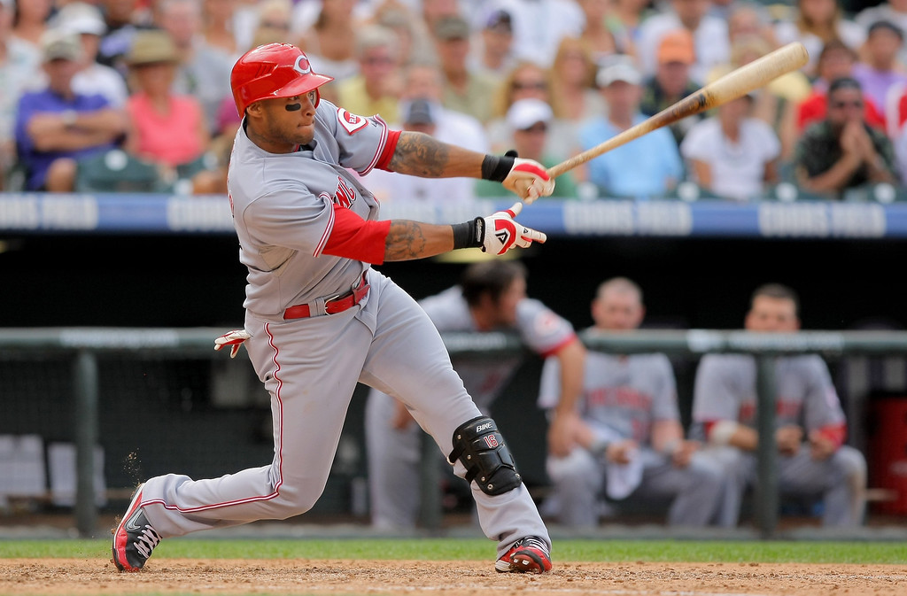 . Darnell McDonald #16 of the Cincinnati Reds takes an at bat against the Colorado Rockies at Coors Field on September 7, 2009 in Denver, Colorado. The Rockies defeated the Reds 4-3.  (Photo by Doug Pensinger/Getty Images)