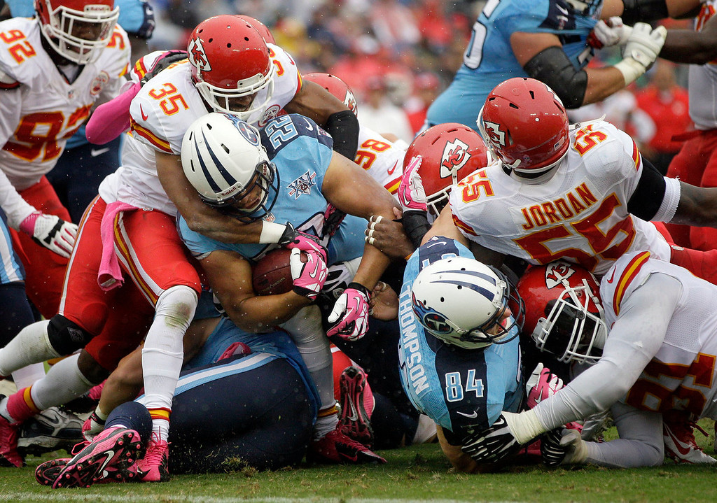 . Tennessee Titans running back Jackie Battle (22) is stopped at the 1-yard line by Kansas City Chiefs defensive back Quintin Demps (35) on fourth down in the second quarter of an NFL football game on Sunday, Oct. 6, 2013, in Nashville, Tenn. (AP Photo/Wade Payne)