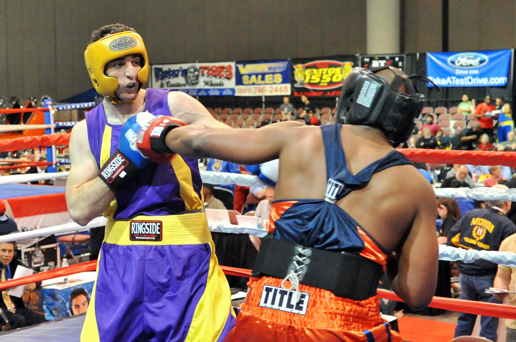 . Tamerlan Tsamaev (L) fights Lamar Fenner (R) during the 201-pound division boxing match during the 2009 Golden Gloves National Tournament of Champions May 4, 2009 in Salt Lake City, Utah.  (Photo by Glenn DePriest/Getty Images)