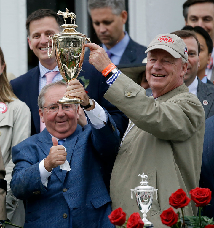 . Orb owner Stuart Janney and trainer Claude McGaughey, left, celebrate after winning the 139th Kentucky Derby at Churchill Downs Saturday, May 4, 2013, in Louisville, Ky.(AP Photo/David Goldman)