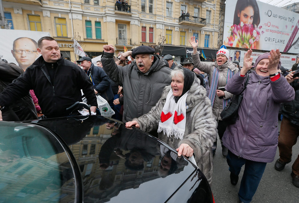 . Supporters of released Ukrainian opposition leader Yulia Tymoshenko accompany her car in downtown Kiev, Ukraine, 28 February 2014. Tymoshenko call them to take away the tent camp near of City district court, which was built supporters after her arrest at Summer 2011.  EPA/SERGEY DOLZHENKO