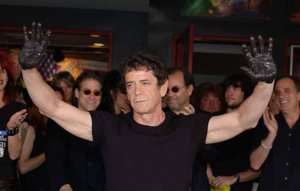 . Musician/poet Lou Reed puts his handprints in cement at a ceremony inducting him into the Hollywood Rock Walk on June 24, 2003 at the Guitar Center store in Hollywood, California.  (Photo by Vince Bucci/Getty Images)