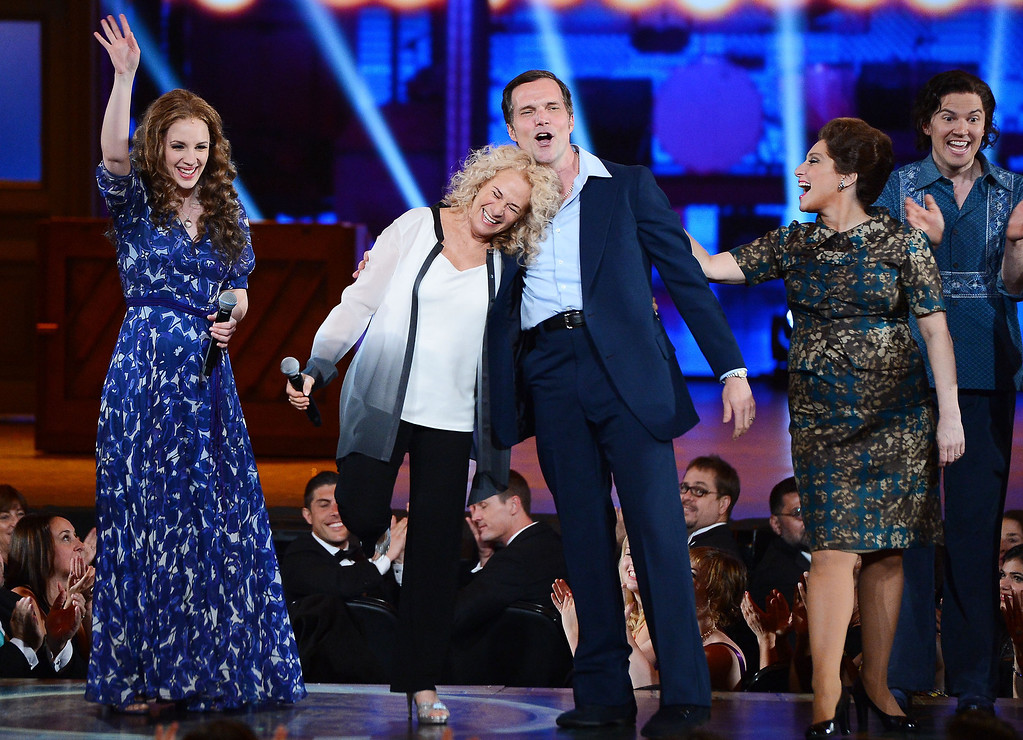 ". (L-R) Jessie Mueller, Carole King and Jake Epstein perform onstage with the cast of ""Beautiful\"" during the 68th Annual Tony Awards at Radio City Music Hall on June 8, 2014 in New York City.  (Photo by Theo Wargo/Getty Images for Tony Awards Productions)"