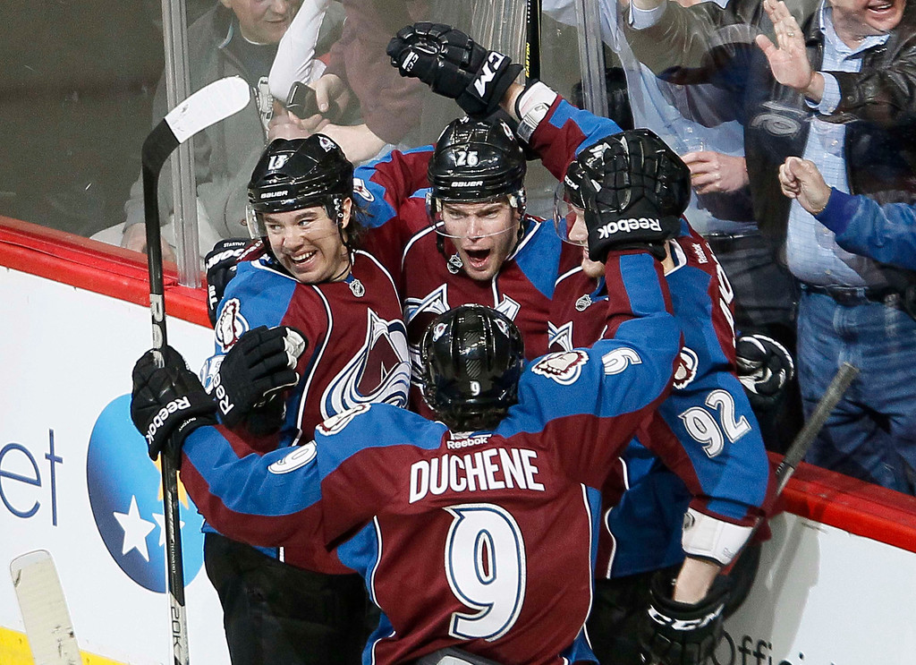 . Colorado Avalanche Paul Stastny (C) celebrates with teammates after scoring a first period goal over the Chicago Blackhawks in their NHL hockey game in Denver March 8, 2013. REUTERS/Rick Wilking