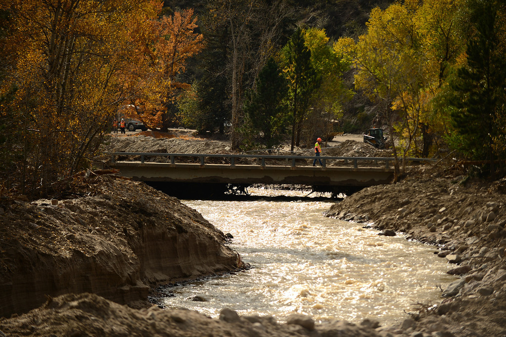 . The damage is still quite extensive in downtown Drake, Co on October 16, 2013 along the Big Thompson River.  For nearly three weeks now, the Colorado Department of Transportation and it\'s contractor Kiewit Infrastructure Co has been working on US 34 from both the Estes Park and Loveland sides to provide a temporary roadway by December 1, 2013. (Photo By Helen H. Richardson/ The Denver Post)