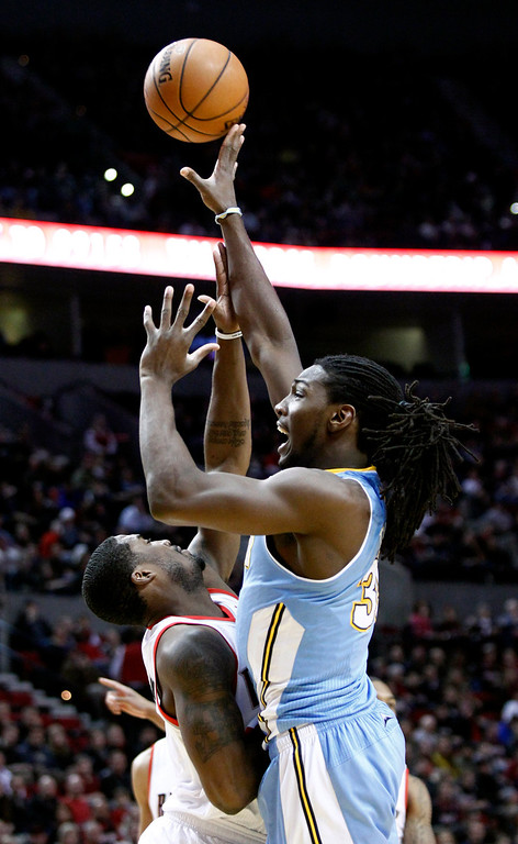 . Denver Nuggets forward Kenneth Faried, right, shoots over Portland Trail Blazers guard Wesley Matthews during the first quarter of an NBA basketball game in Portland, Ore., Thursday, Dec. 20, 2012. (AP Photo/Don Ryan)