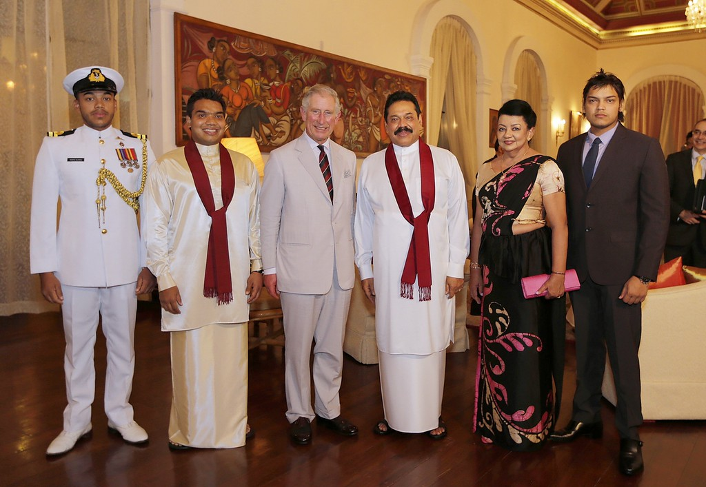 . In this handout photo provided by Sri Lankan Government, Prince Charles, Prince of Wales (3rd L) poses with Sri Lankan President Mahinda Rajapaksa (3rd R) and his family during a reception at the President\'s House on November 14, 2013 in Colombo, Sri Lanka.   (Photo by Sri Lankan Government via Getty Images)
