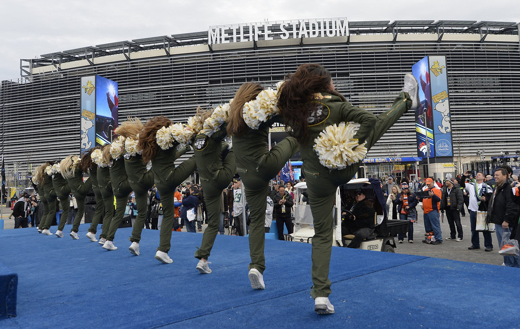 . Dancers perform at MetLife Stadium in East Rutherford, New Jersey, on February 2, 2014 ahead of Superbowl 48. The AFC Denver Broncos and the NFC Seattle Seahawks square off later Sunday to see who takes home the Vince Lombardi Trophy and claim the world championship.  TIMOTHY A. CLARY/AFP/Getty Images
