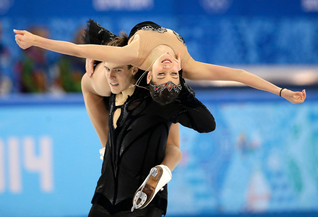 . Elena Ilinykh and Nikita Katsalapov of Russia compete in the ice dance free dance figure skating finals at the Iceberg Skating Palace during the 2014 Winter Olympics, Monday, Feb. 17, 2014, in Sochi, Russia. (AP Photo/Darron Cummings)
