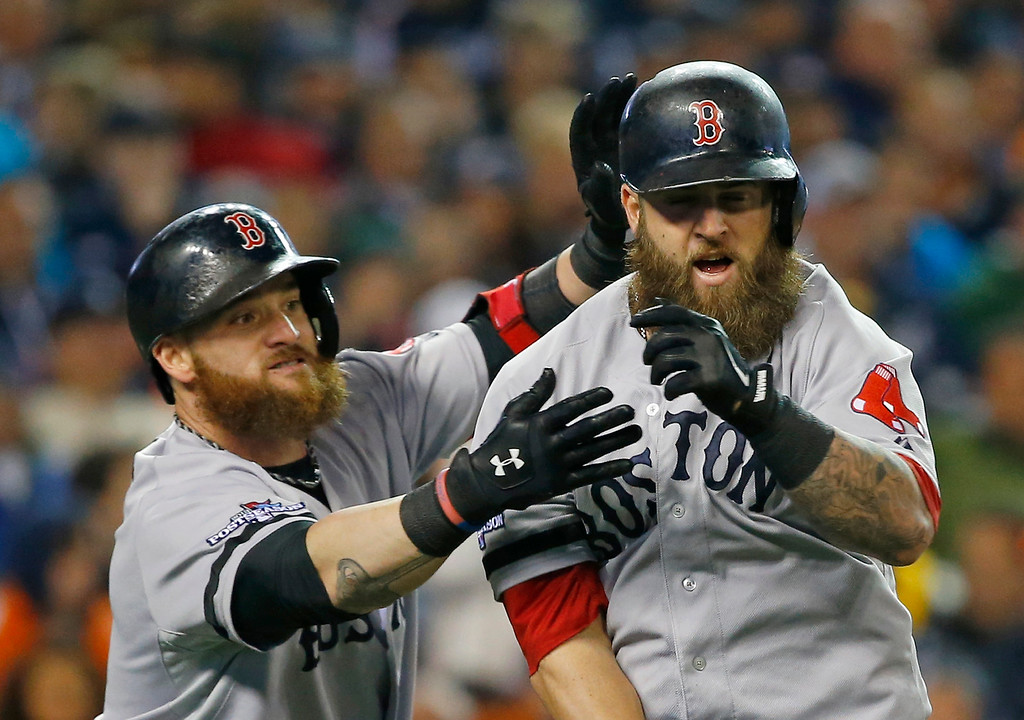 . Boston Red Sox\'s Mike Napoli, right, is greeted by Jonny Gomes following a home run by Napoli in the second inning during Game 5 of the American League baseball championship series against the Detroit Tigers, Thursday, Oct. 17, 2013, in Detroit. (AP Photo/Paul Sancya)