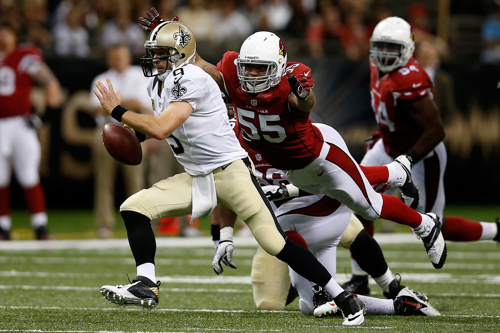 . Drew Brees #9 of the New Orleans Saints is sacked by  John Abraham #55 of the Arizona Cardinals at the Mercedes-Benz Superdome on September 22, 2013 in New Orleans, Louisiana.  (Photo by Chris Graythen/Getty Images)
