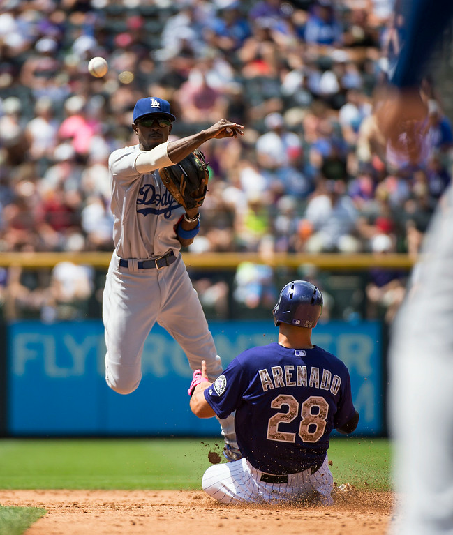 . Colorado Rockies third baseman Nolan Arenado (28) is forced out at second base as Los Angeles Dodgers shortstop Carlos Triunfel (45) during the 6th inning July 6, 2014 at Coors Field. (Photo by John Leyba/The Denver Post)