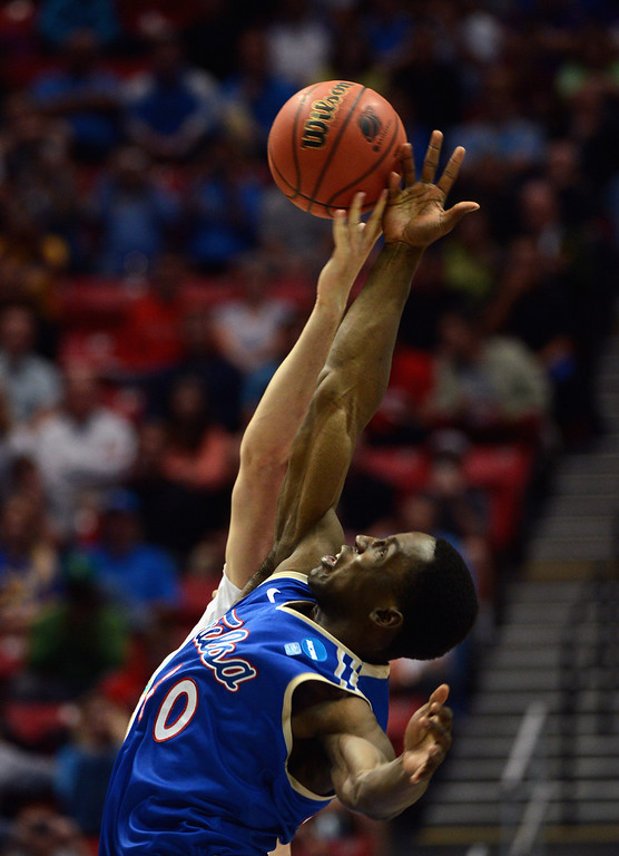 . D\'Andre Wright #40 of the Tulsa Golden Hurricane tips off against the UCLA Bruins during the second round of the 2014 NCAA Men\'s Basketball Tournament at Viejas Arena on March 21, 2014 in San Diego, California.  (Photo by Donald Miralle/Getty Images)