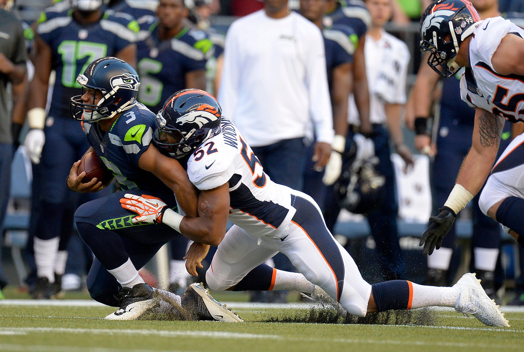 . SEATTLE, WA. - AUGUST 17: Denver Broncos outside linebacker Wesley Woodyard (52) catches Seattle Seahawks quarterback Russell Wilson (3) from behind after a short gain in the first quarter August 17, 2013 at Century Link Field. (Photo By John Leyba/The Denver Post)