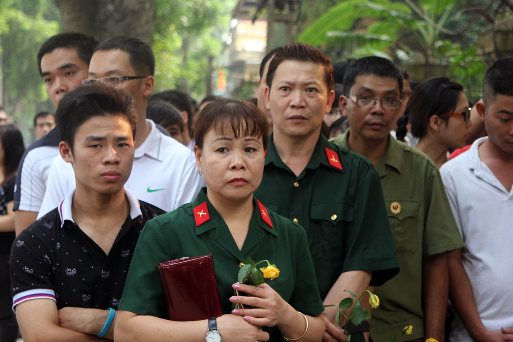 . Vietnamese army officers wait outside the late Gen. Vo Nguyen Giap\'s house in Hanoi, Vietnam on Sunday, Oct. 6, 2013. Several thousand people visited the house to pay their respects to the general, who led Vietnam\'s wars against the French and the United States. Giap died Friday at the age of 102. (AP Photo/Din Hau)