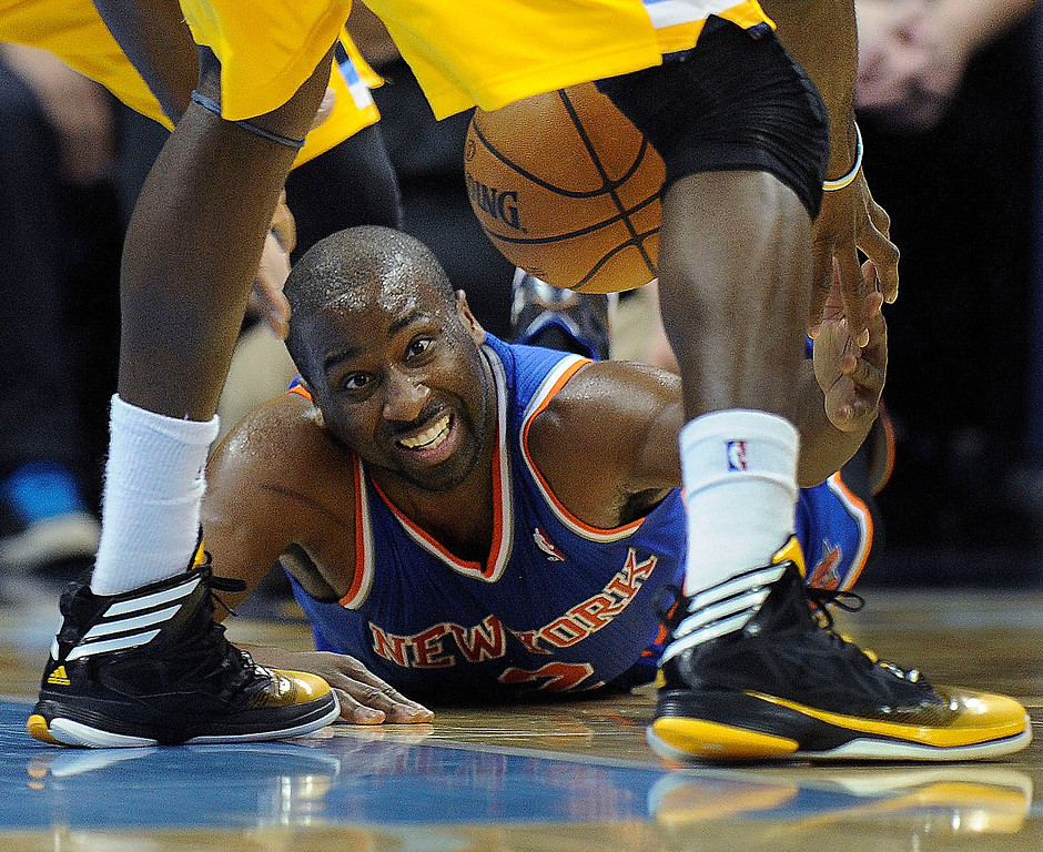 . New York guard Raymond Felton lost a loose ball to Kenneth Faried in the second half. Photo By Karl Gehring/The Denver Post