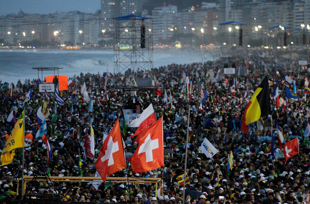 . Thousands of young pilgrims gather on Copacabana Beach for a World Youth Day Mass in Rio de Janeiro, Brazil, Tuesday, July 23, 2013. Pope Francis arrived in Rio de Janeiro on Monday to begin a weeklong visit to participate in the World Youth Day festival. (AP Photo/Jorge Saenz)