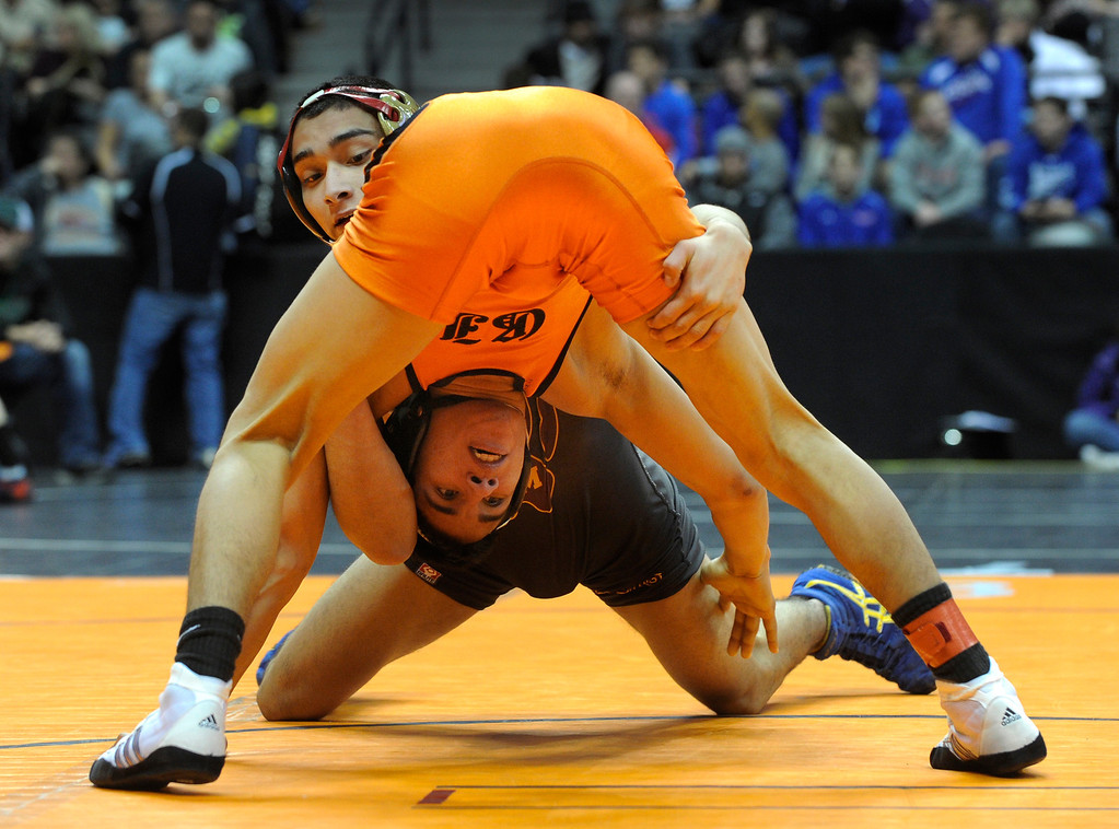 . DENVER, CO. - FEBRUARY 21: Rocky Mountain sophomore Roman Ortiz, top, peered over the backside of Grand Junction opponent Louis Guillen, bottom, during a 138-pound bout in class 5A Thursday night. The CHSAA State Wrestling Tournament kicked off Thursday, February 21, 2013 at the Pepsi Center in Denver. (Photo By Karl Gehring/The Denver Post)