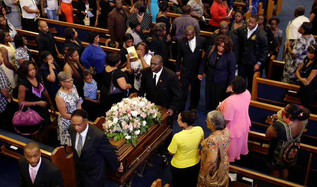 . The casket of 6-year-old Ahlittia North is taken out of the church at the conclusion of her funeral services in Gonzales, La., Monday, July 22, 2013. Ahlittia disappeared from her apartment late last Friday night or early Saturday morning in Harvey, La., a suburb of New Orleans. Her body was found in a trash bin near the apartment. Matthew Flugence, cousin of Ahlittia\'s stepfather Albert Hill, was arrested for the murder. Behind the casket are the girl\'s biological mother, Lisa North, and Albert Hill. (AP Photo/Gerald Herbert)