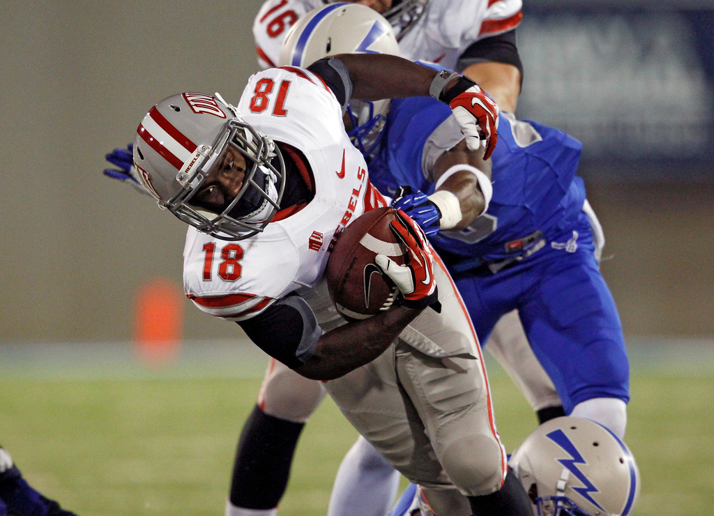 . UNLV wide receiver Marcus Sullivan, fronbt, is pulled down after making a catch by Air Force linebacker Connor Healy in the second quarter of an NCAA football game at Air Force Academy, Colo., on Thursday, Nov. 21, 2013. (AP Photo/David Zalubowski)