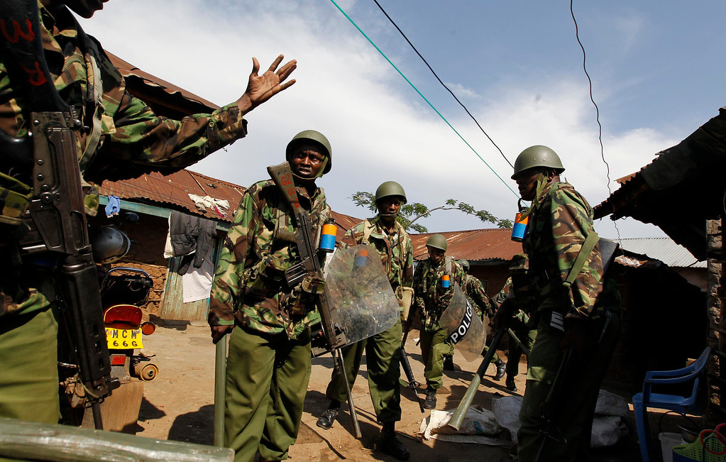 . Riot police search for demonstrators as tension arises after Uhuru Kenyatta was declared winner of Kenya\'s presidential election in Kenya\'s western town of Kisumu, 350km (218 miles) from the capital Nairobi, March 9, 2013. REUTERS/Thomas Mukoya
