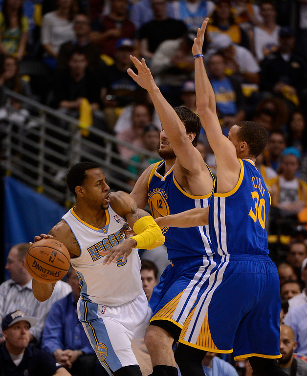 . Denver Nuggets shooting guard Andre Iguodala (9) looks to pass against Golden State Warriors center Andrew Bogut (12) and Golden State Warriors point guard Stephen Curry (30) in the third quarter. The Denver Nuggets took on the Golden State Warriors in Game 5 of the Western Conference First Round Series at the Pepsi Center in Denver, Colo. on April 30, 2013. (Photo by John Leyba/The Denver Post)