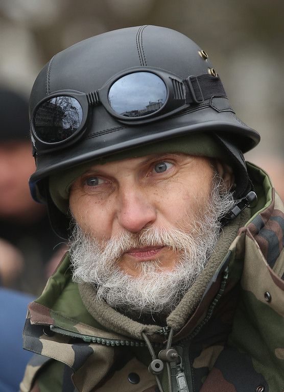 . A man wears a helmet at a gathering of pro-Russian supporters outside the Crimean parliament building on February 28, 2014 in Simferopol, Ukraine.  (Photo by Sean Gallup/Getty Images)