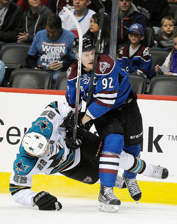 . Colorado Avalanche left wing Gabriel Landeskog, right, of Sweden, knocks San Jose Sharks defenseman Dan Boyle to the ice during the first period of an NHL hockey game, Sunday, March 10, 2013, in Denver.  (AP Photo/Chris Schneider)