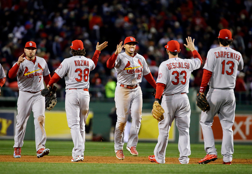 . The St. Louis Cardinals celebrate after defeating the Boston Red Sox, 4-2, in Game 2 of baseball\'s World Series Thursday, Oct. 24, 2013, in Boston. The series is at 1-1. (AP Photo/Matt Slocum)