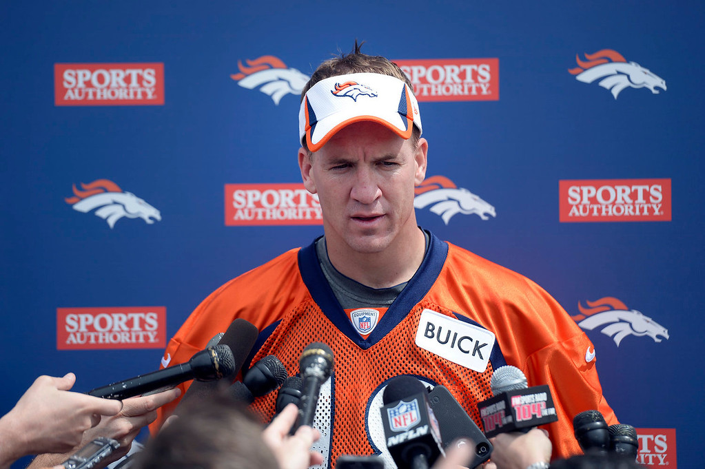. Denver Broncos quarterback Peyton Manning answers questions from the media after practice September 1, 2013 at Dove Valley. (Photo by John Leyba/The Denver Post)