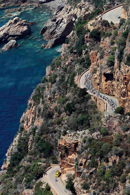 . An aerial view shows the pack of riders as they cycle along the coast during the 145,5 km third stage of the centenary Tour de France cycling race from Ajaccio to Calvi, on the French Mediterranean island of Corsica July 1, 2013. REUTERS/Pascal Pochard-Casabianca/Pool