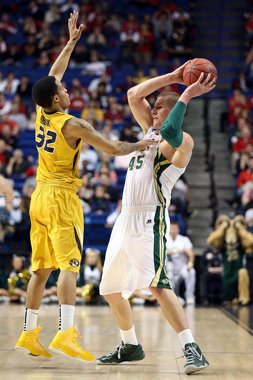 . LEXINGTON, KY - MARCH 21:  Colton Iverson #45 of the Colorado State Rams handles the ball against Jabari Brown #32 of the Missouri Tigers during the second round of the 2013 NCAA Men\'s Basketball Tournament at the Rupp Arena on March 21, 2013 in Lexington, Kentucky.  (Photo by Andy Lyons/Getty Images)
