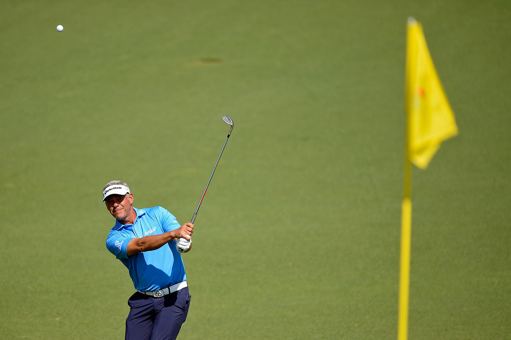 . Darren Clarke of Northern Ireland plays a pitch shot on the second hole during the third round of the 2014 Masters Tournament at Augusta National Golf Club on April 12, 2014 in Augusta, Georgia.  (Photo by Harry How/Getty Images)