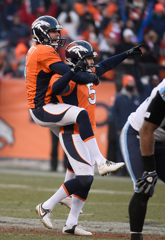 . DENVER, CO - DECEMBER 08: Denver Broncos kicker Matt Prater (5) celebrates with Denver Broncos punter Britton Colquitt (4)  his record 64-yard field goal is good in the second quarter. The Denver Broncos take on the Tennessee Titans at Sports Authority Field at Mile High in Denver on December 8, 2013. (Photo by John Leyba/The Denver Post)