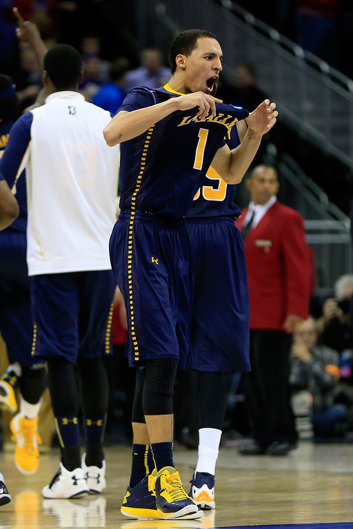 . KANSAS CITY, MO - MARCH 22:  D.J. Peterson #1 of the La Salle Explorers celebrates their 63-61 win over the Kansas State Wildcats during the second round of the 2013 NCAA Men\'s Basketball Tournament at the Sprint Center on March 22, 2013 in Kansas City, Missouri.  (Photo by Jamie Squire/Getty Images)