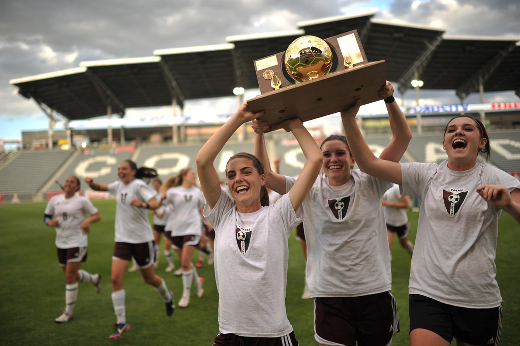 . COMMERCE CITY, CO. - MAY 22 : From front left, Amy Eclert (22), Aspen Peifer (9) and Hunter Peifer (1) of Cheyenne Mountain High School celebrate winning  of 4A girl\'s soccer championship game against Broomfield High School at Dick\'s Sporting Goods Park. Commerce City, Colorado. May 22, 2013. Cheyenne Mountain High School won 2-0. (Photo By Hyoung Chang/The Denver Post)