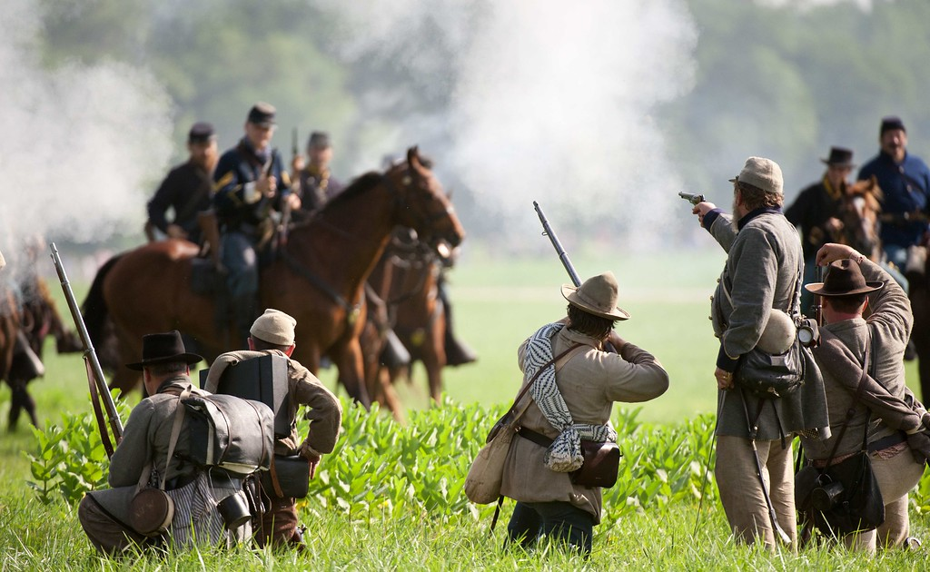 . Confederate troops fire at charging Union cavalry troops during a re-enactment of the Battle of Gettysburg on June 28, 2013 at the start of the 150th Gettysburg celebration and re-enactments in Gettysburg, Pennsylvania. Over three days, more than 10,000 re-enactors will pay tribute the major battles that took place in Gettysburg during the 1861-1865 US Civil War. KAREN BLEIER/AFP/Getty Images