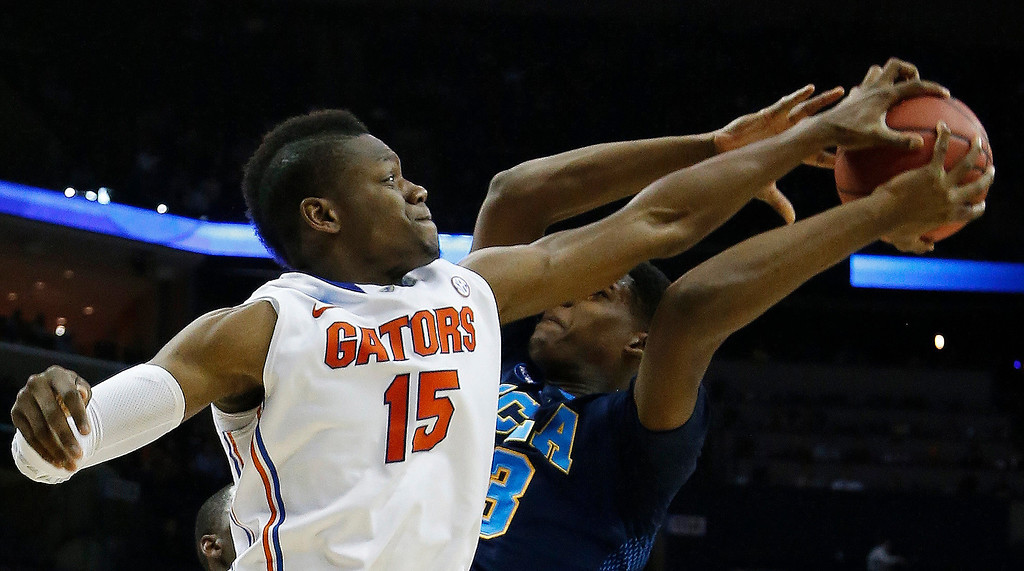 . Florida forward Will Yeguete (15) blocks a shot by UCLA forward/center Tony Parker (23) during the second half in a regional semifinal game at the NCAA college basketball tournament, Thursday, March 27, 2014, in Memphis, Tenn. (AP Photo/Mark Humphrey)