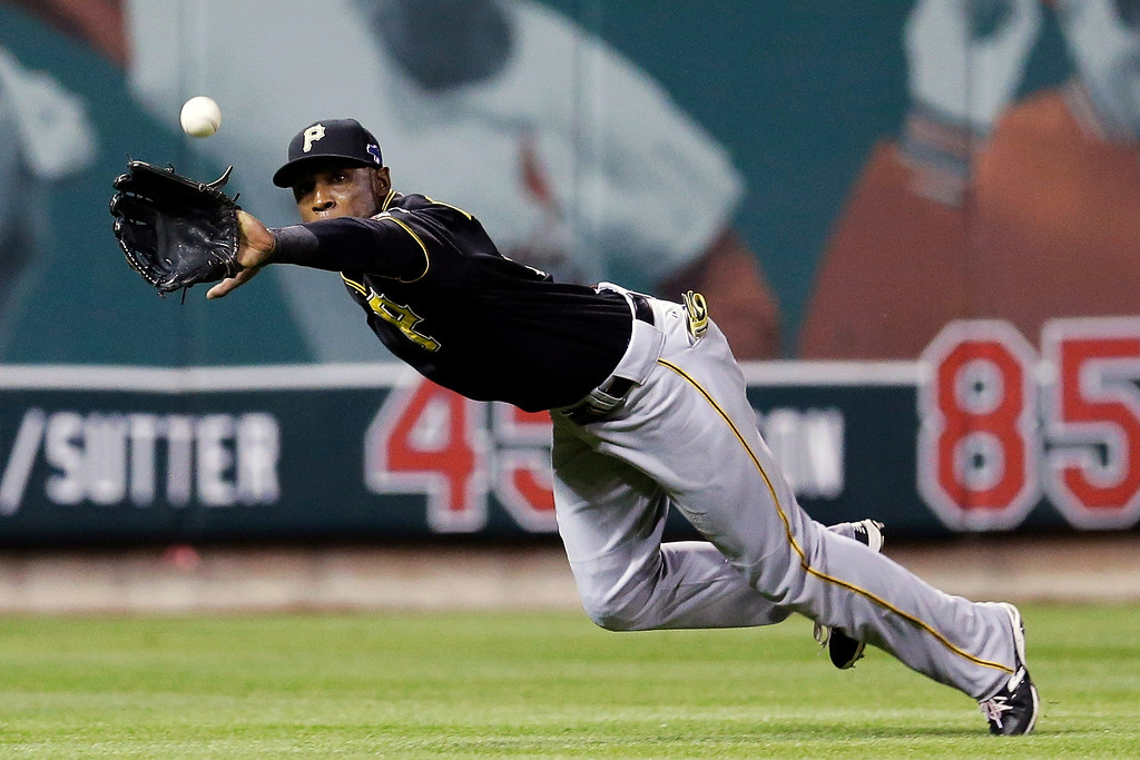 . Pittsburgh Pirates left fielder Starling Marte makes a diving catch on a ball hit by St. Louis Cardinals\' Matt Carpenter in the third inning Game 5 of a National League baseball division series on Wednesday, Oct. 9, 2013, in St. Louis. (AP Photo/Charlie Riedel)