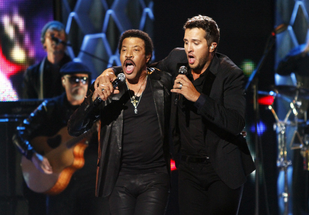 """. Luke Bryan, right, and Lionel Richie perform at the CMT \""""Artists of the Year\"""" show held at the Music City Center on Tuesday, Dec. 3, 2013, in Nashville, Tenn. (Photo by Wade Payne/Invision/AP)"""