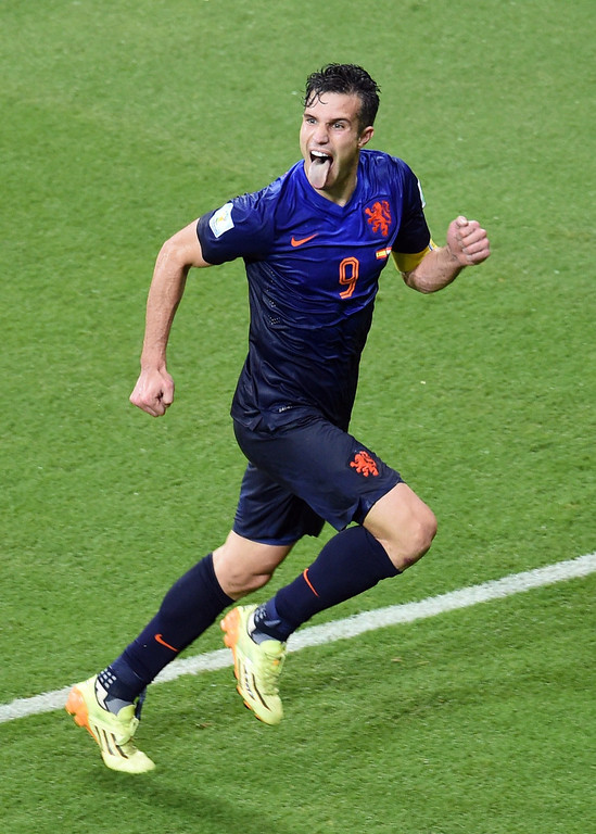 . Netherlands\' forward Robin van Persie celebrates after scoring during a Group B football match between Spain and the Netherlands at the Fonte Nova Arena in Salvador during the 2014 FIFA World Cup on June 13, 2014. DIMITAR DILKOFF/AFP/Getty Images