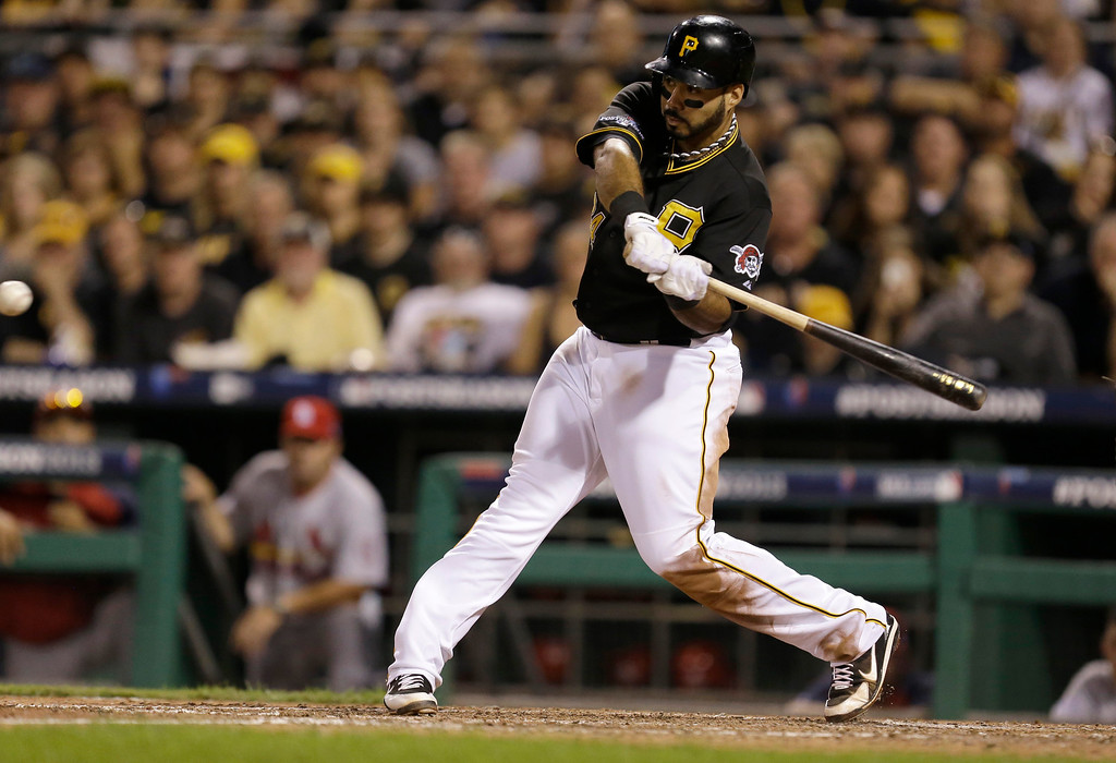 . Pittsburgh Pirates\' Pedro Alvarez drives in Josh Harrison with the go-ahead run with a single to right field in the eighth inning of Game 3 of a National League division baseball series against the St. Louis Cardinals, Sunday, Oct. 6, 2013, in Pittsburgh. The Pirates won 5-3 to take a two games to one lead in the best-of-five series. (AP Photo/Gene J. Puskar)