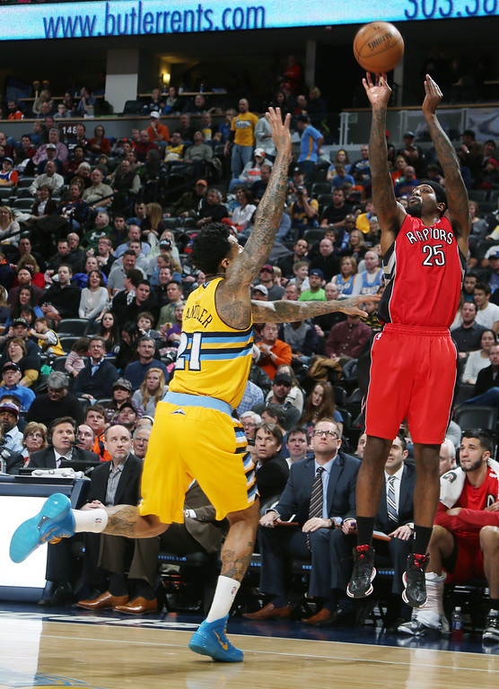 . Toronto Raptors forward John Salmons, right, goes up to shoots over Denver Nuggets forward Wilson Chandler in the first quarter of an NBA basketball game in Denver, Friday, Jan. 31, 2014. (AP Photo/David Zalubowski)