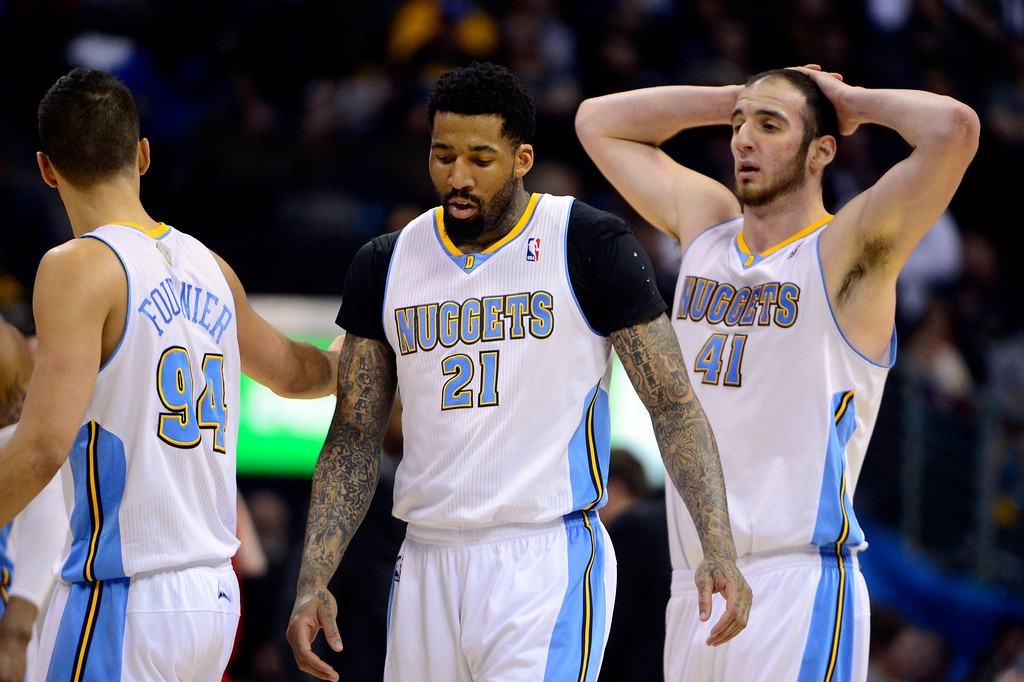 . DENVER, CO - APRIL 14: Evan Fournier (94) of the Denver Nuggets, Wilson Chandler (21) and Kosta Koufos (41) walk off the court during the first half of action. The Denver Nuggets play the Portland Trail Blazers at the Pepsi Center. (Photo by AAron Ontiveroz/The Denver Post)