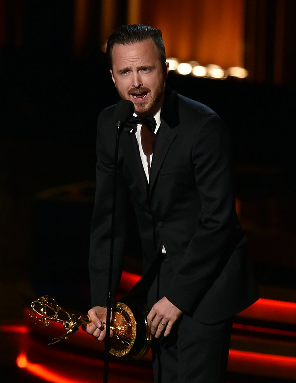 . Actor Aaron Paul accepts Outstanding Supporting Actor in a Drama Series for \'Breaking Bad\' onstage at the 66th Annual Primetime Emmy Awards held at Nokia Theatre L.A. Live on August 25, 2014 in Los Angeles, California.  (Photo by Kevin Winter/Getty Images)
